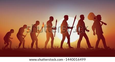 Concept de la pensée baba cool des sixties, avec le symbole de l'évolution de Darwin qui aboutit sur un homme hippie marchant en tenant sa guitare sur son épaule. #1440016499