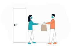 Concept man in medicine mask door-to-door delivery worker hands a bag with food to the addressee.