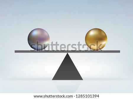 Concept of absolute parity with two same size balls but different color in perfect balance on a balance.