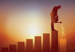 Concept of career development and progress on the social ladder with a man who climbs little by little, a staircase by watering the next step to enable him to reach the leading position.