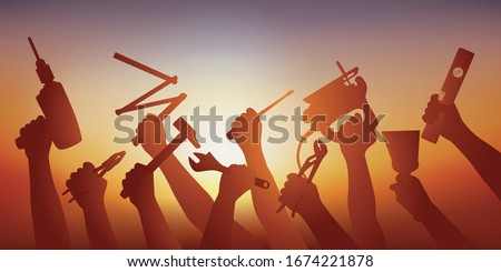Concept of construction site and development work with the symbol of several hands of craftsmen who hold DIY tools. Stock photo ©