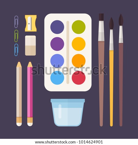 Concept of creativity and education. Materials for drawing: paints, brushes, pencils, sharpener, paper clips and glass of water.