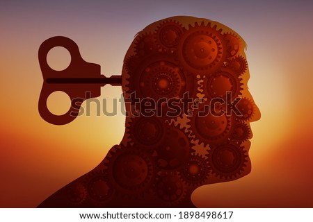 Concept of intellectual manipulation with the head of a man whose brain is replaced by a system of gears driven by a key.