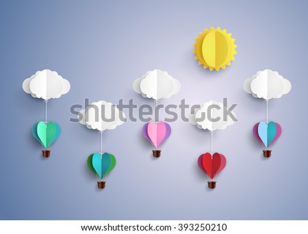 concept of love and valentine day, origami made hot air balloon in a heart shape flying on blue sky. paper art style.