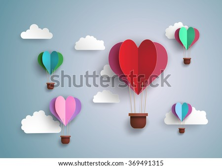 concept of love and valentine day, origami made hot air balloon in a heart shape . paper art and craft style.