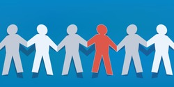 Concept of solidarity and respect for difference with a human chain linking hand-carved characters in paper, one of which is of another color.