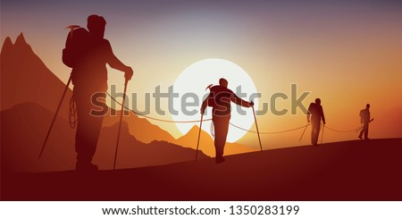 Concept of solidarity, with mountaineers going on an expedition while walking on a ridge of a mountain, before climbing a summit
