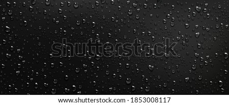 Condensation water drops on black window background. Rain droplets with light reflection on dark glass surface, abstract wet texture, scattered pure aqua blobs pattern Realistic 3d vector illustration
