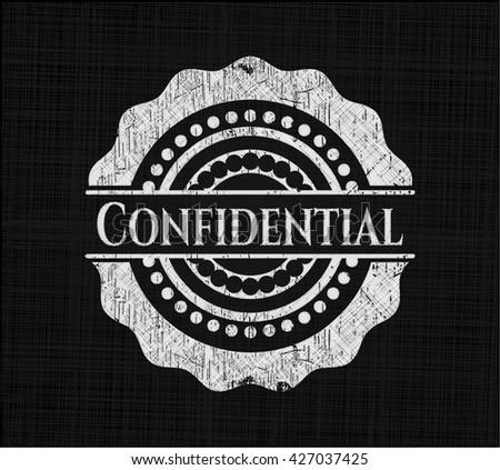 Confidential chalkboard emblem written on a blackboard