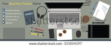 Contemporary work space including: laptop, digital pen and pad, mobile phone, pens, sketch papers, coffee and cookies, notebook, headphones, computer mouse and eyeglasses - Shutterstock ID 315054197