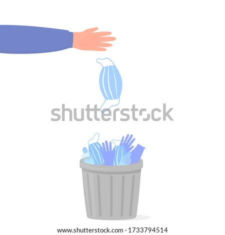 Coronavirus quarantine is over. Pandemic end. COVID-2019. A hand throws a medical surgical mask into a trash can with used surgical gloves and sanitizers Photo stock ©