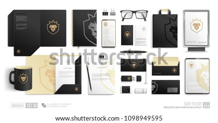 Corporate Identity Brand Mockup set on white background. Realistic Branding mock-up of city lightbox, folder, blank, phone, tablet. Business Stationery Black mockup with golden lion crown icon logo Foto stock ©