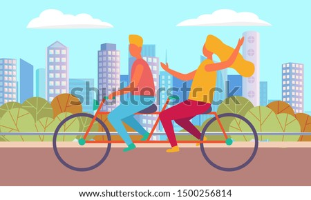 couple cycling in city