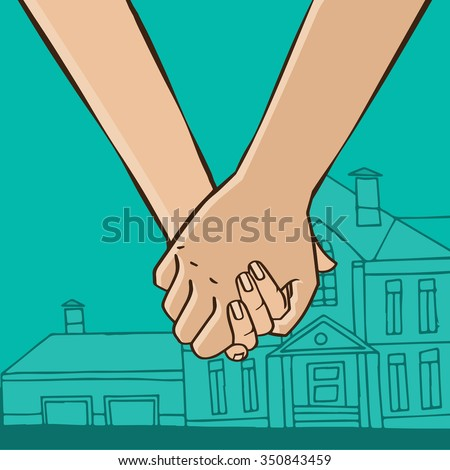 couple hold hands on the
