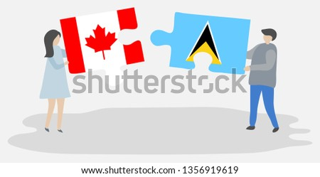 Couple holding puzzle pieces with Canadian and Saint Lucian flags. Canada and Saint Lucia national symbols together.