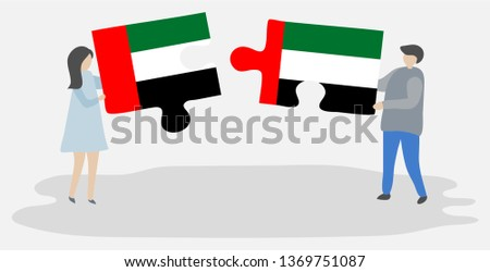 Couple holding two puzzles pieces with Emirian and Emirian flags. United Arab Emirates and United Arab Emirates national symbols together.
