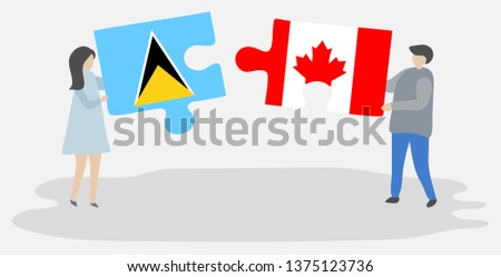 Couple holding two puzzles pieces with Saint Lucian and Canadian flags. Saint Lucia and Canada national symbols together.