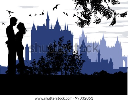 couple hugging against the backdrop of an ancient palace