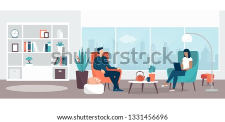 couple relaxing at home sitting