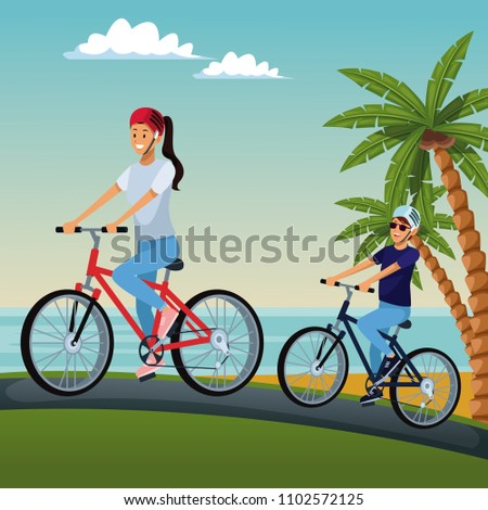 couple riding bikes at beach
