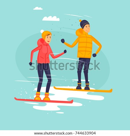 couple riding snowboards