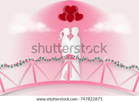 couple standing on the pink