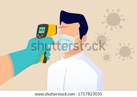 COVID-19 Coronavirus flu patient with high temperature fever concept, doctor holding infrared thermometer to measure body temperature at forehead result in high temperature fever with virus pathogens