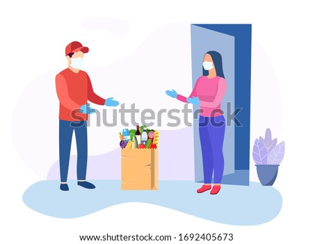 COVID-19. Quarantine in the city. Coronavirus epidemic. Courier man in a protective medical mask. bag full of groceries products. Free food delivery. Stay home