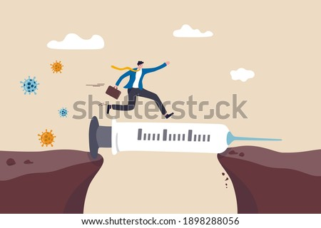 COVID-19 vaccine solution to economic recovery, immunity to continue business and get pass pandemic problem concept, businessman walk on vaccine syringe as bridge to next cliff with virus pathogen.