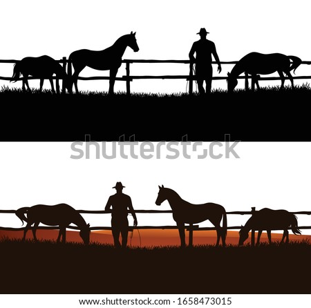 cowboy and horse herd behind