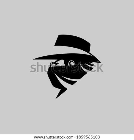 Cowboy masked outlaw side view portrait symbol on gray backdrop. Design element Foto d'archivio ©