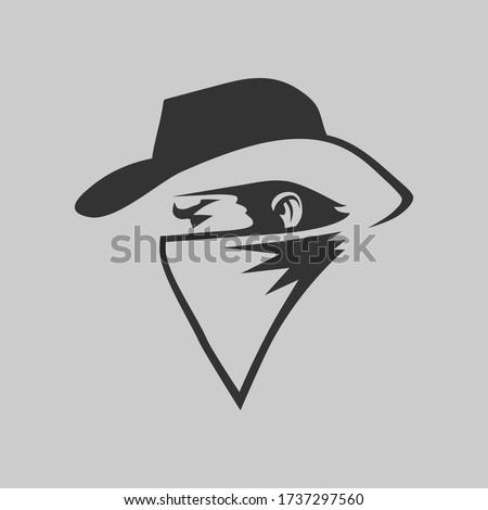 Cowboy outlaw symbol side view on gray backdrop. Design element Foto d'archivio ©