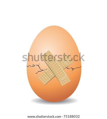Cracked nest egg isolated on white