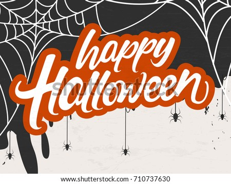 Creative and Scary background for Halloween celebration with Happy Halloween hand lettering text and hanging spiders.