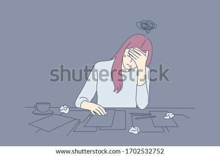 Creative crisis, fatigue, mental stress, depression, frustration concept. Young depressed frustrated upset woman or girl, writer artist has creative crisis. Fatigue, raising of mental stress, headache