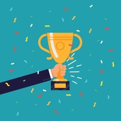 Creative flat design vector concept on businessman hand holding gold cup award icon. Winner prize goblet. Success and business achievements concept with award cup and confetti