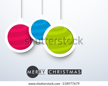 Creative hanging Xmas balls in pink, blue and green color for Merry Christmas celebration, can be use as sticker, label or tags.
