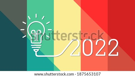 Creative light bulb idea with 2022 new year design with a light-bulb on the beautiful color palette background. 2022 glowing