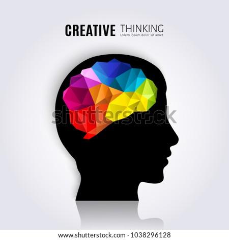 Creative mind. Concept of the human brain inside black head profile. Polygon style.