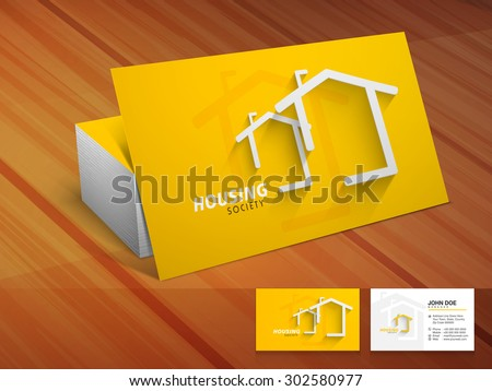 Creative shiny business or visiting card design in yellow color on wooden background for housing society.