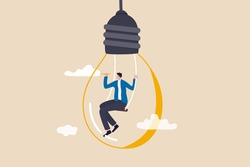 Creativity and imagination to create content, writer or creator inspiration for new idea, think and brainstorm concept, motivated man sitting on swing inside lightbulb idea using pencil drawing cloud.