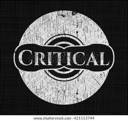Critical chalkboard emblem on black board