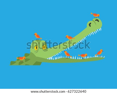Crocodile and bird. Little birds clean alligator teeth. Symbiotic relationship