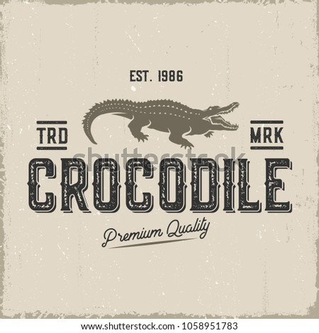 Crocodile retro label isolated on kraft paper.Vector illustration.