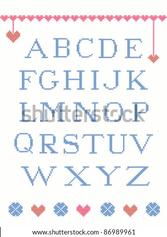 Cross stitch alphabet with design elements suitable for christmas