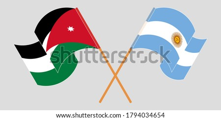 Crossed and waving flags of Jordan and Argentina