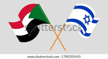 Crossed and waving flags of Sudan and Israel