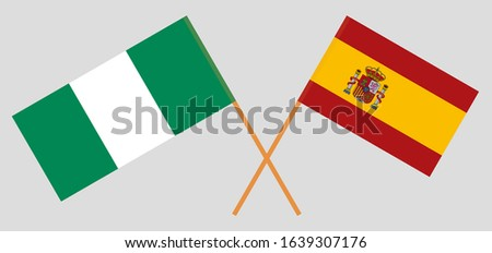 Crossed flags of Nigeria and Spain. Official colors. Correct proportion. Vector illustration