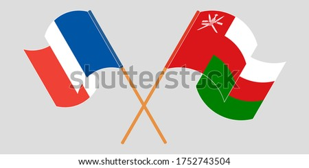 crossed flags of oman and france