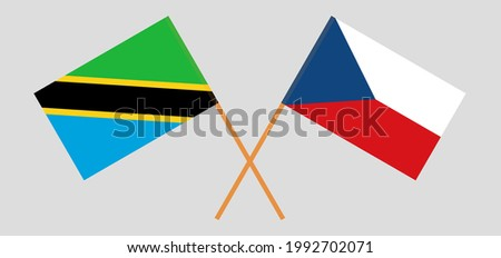 Crossed flags of Tanzania and Czech Republic. Official colors. Correct proportion
